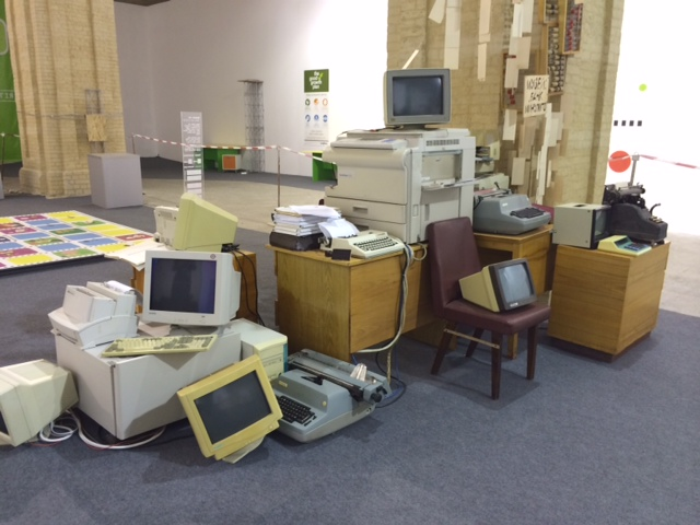 An art installation of computers, typewriters, adding machines, and other objects is at the center of the Finance Lab