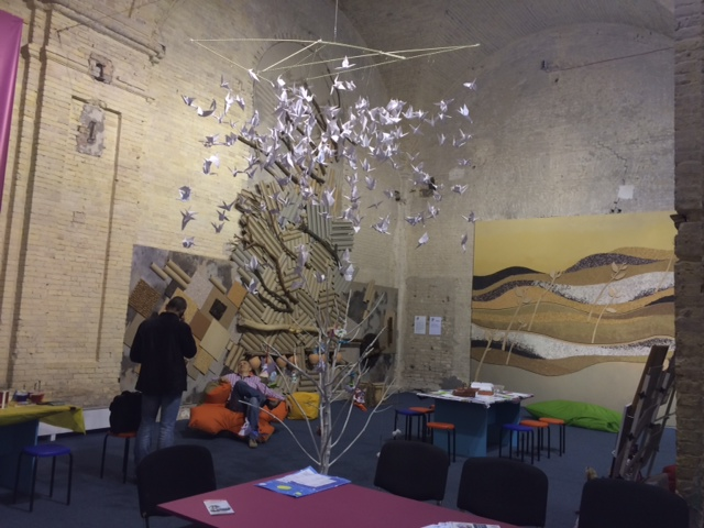 The Art Lab offers activities for visitors to create artwork of all kinds, including origami cranes to add to the display in the center of the space