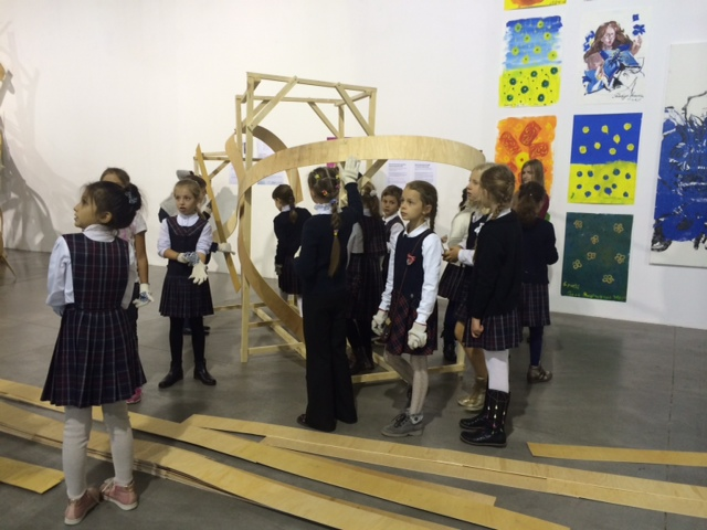 At the festival, kids worked with an artist to build a structure out of strips of flexible wood