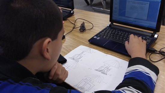 Student using CAD to sketch an invention.