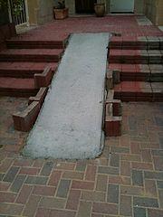 Poorly retrofitted wheelchair ramp.
