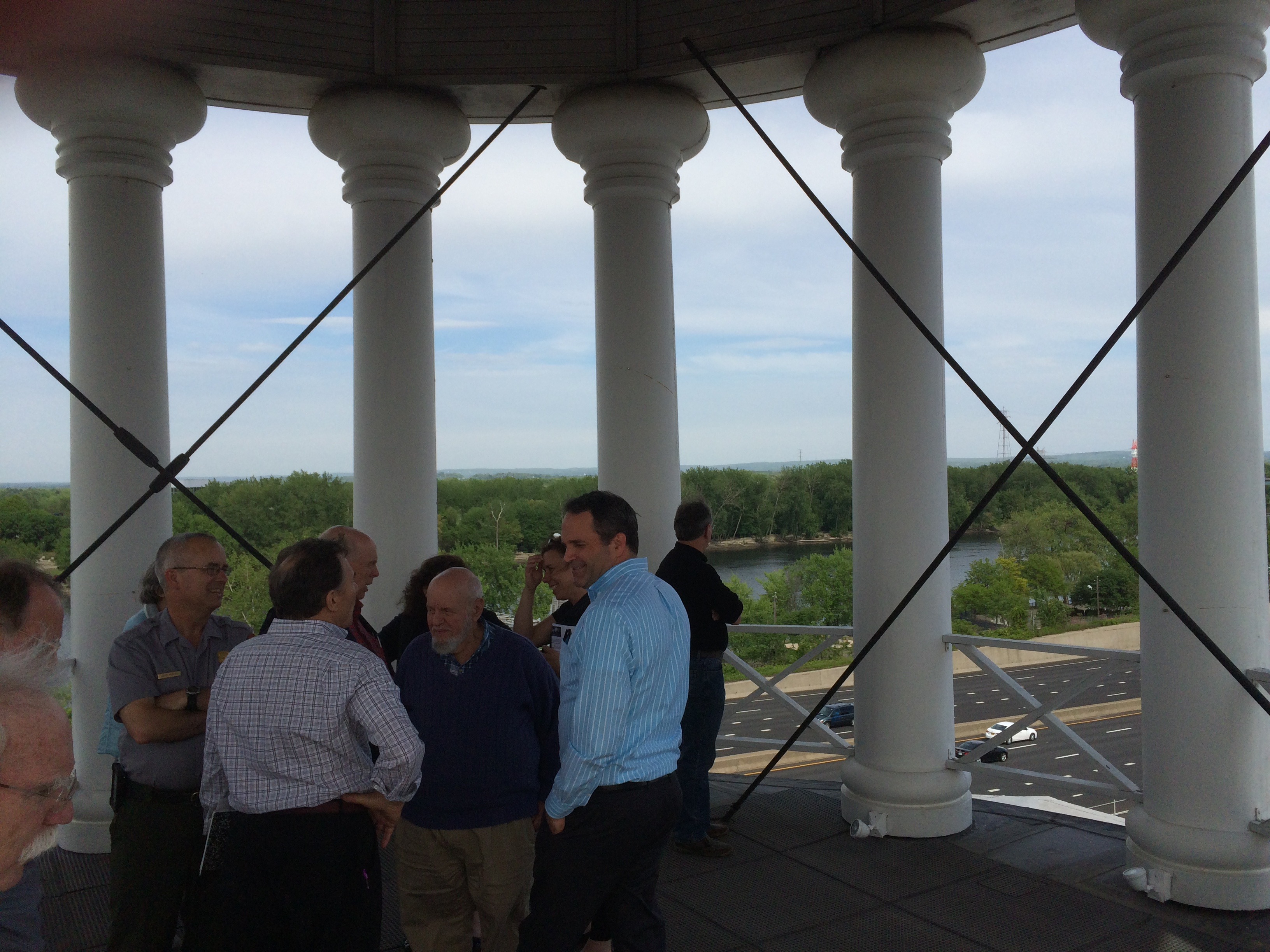 Our third tour guide was Larry Dooley, general manager of CG Management (middle right, left hand in pocket). Larry took us up inside the onion dome atop the East Armory; Interstate-91 and the Connecticut River are in the background. Photo by Eric Hintz.