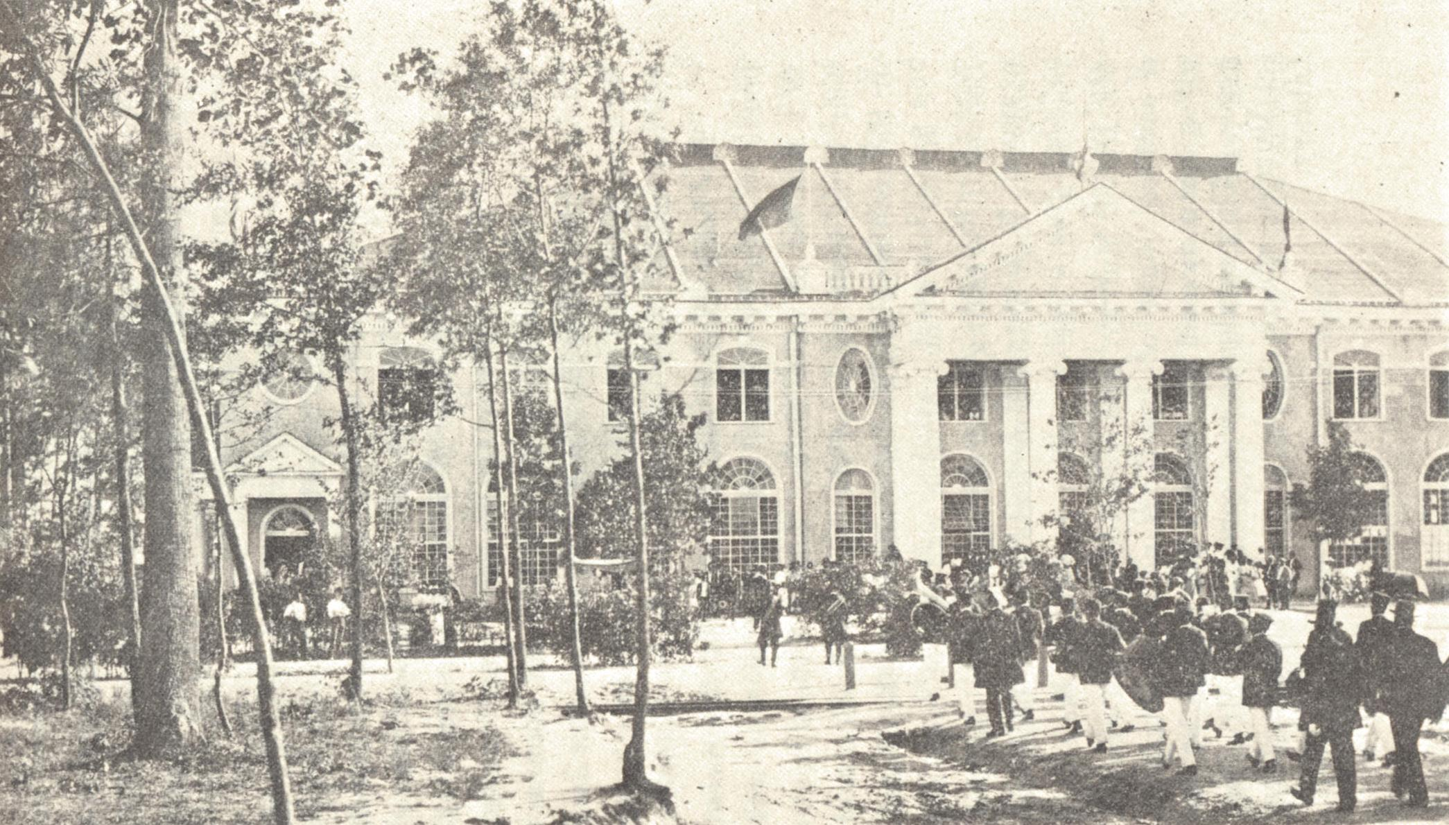 A marching band parades before the front entrance of Negro Building, Jamestown Tercentennial Exposition, 24 August 1907.