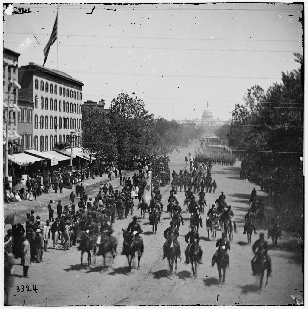 Grand Review of the Army [Cavalry] and infantry passing on Pennsylvania Avenue near the Treasury, Washington, District of Columbia, May 23 or 24, 1865.