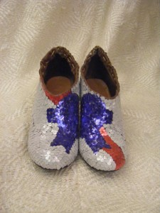PBR shoes made from over 2,000 hole-punched aluminum circles; woven white plastic bags in background.