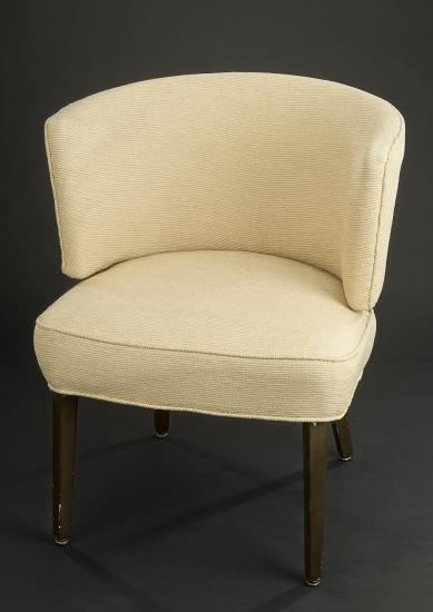 Beige upholstered chair with deeply curved back from ocean liner SS United States, 1952