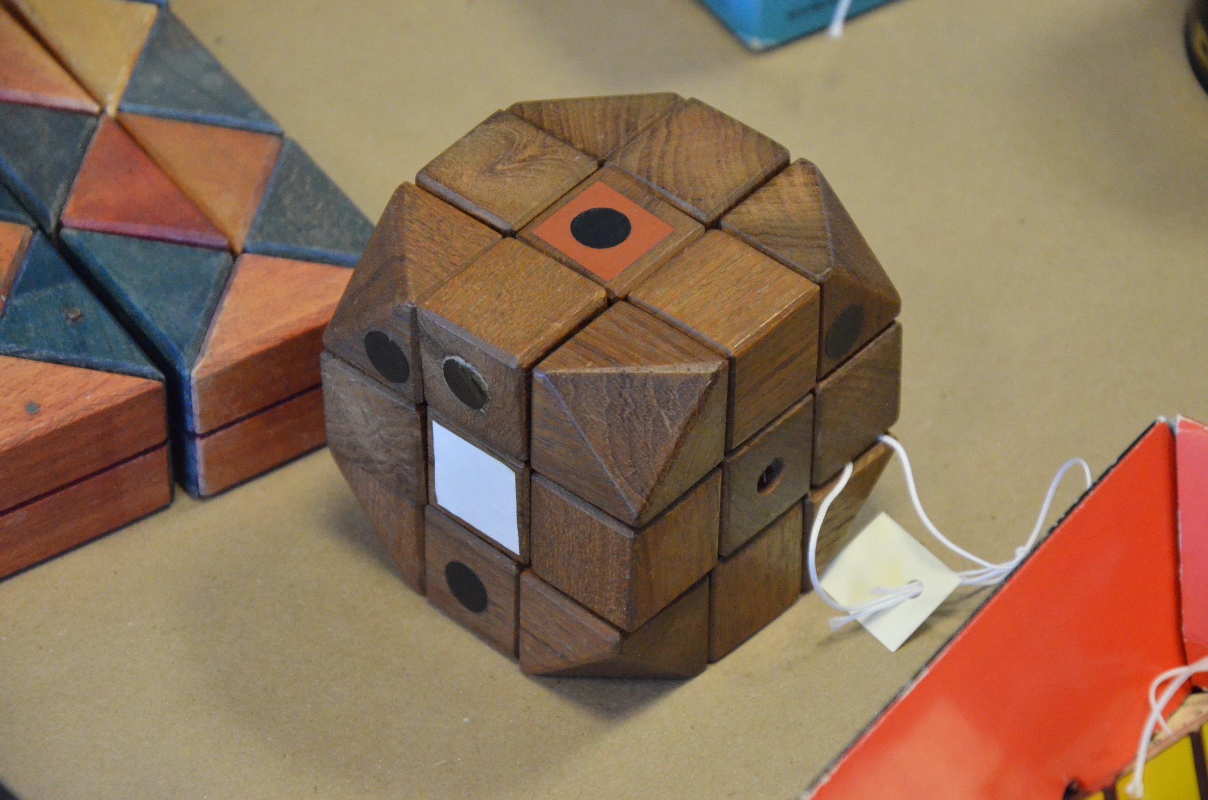 Original Rubik's cube prototype, dark and colored wood. Via Google Images.