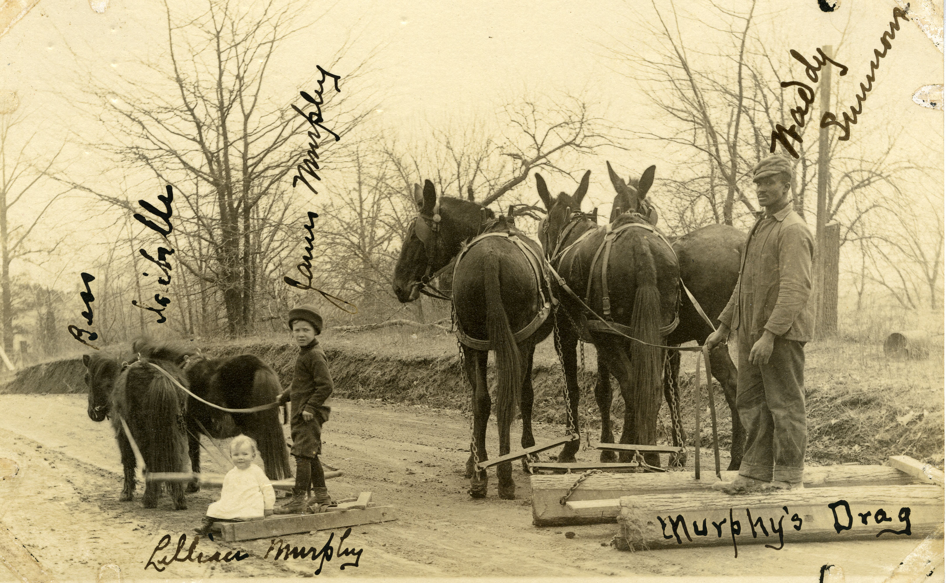 Photograph, James and Lillian Murphy and Waddy Summer, using a drag, Martin, Tennessee, undated. (AC1332-0000003).