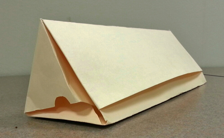 Image of Author's prism-shaped box.