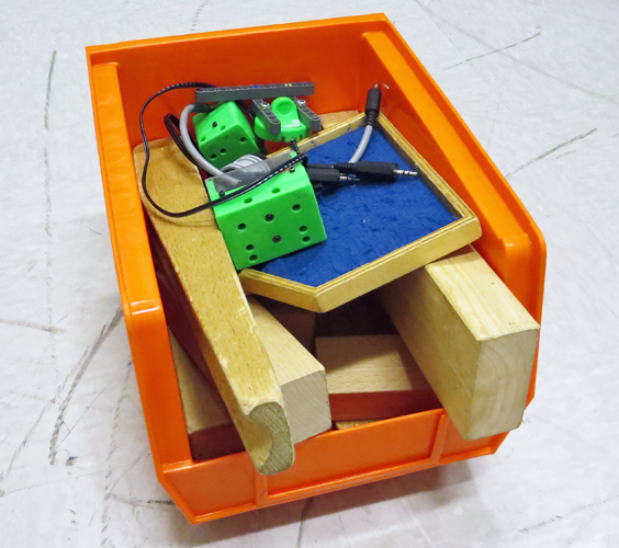 Bin filled with ultrasonic sensor activity components
