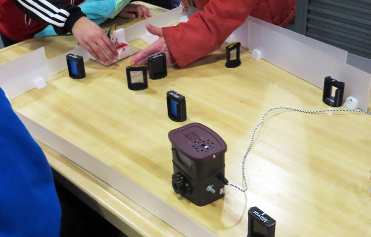 Spark!Lab visitors experimenting with Tim Pula's laser maze.
