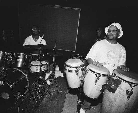 "Go-go musicians practice drums and congas. As musicians sometimes say, ""practice makes pocket,"" meaning that percussion creates a rhythmic center for the music. Photograph from 2010 by Thomas Sayers Ellis, used with permission."