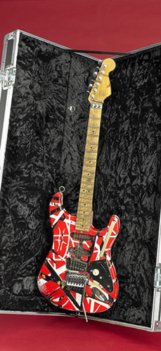 "This guitar was played by Eddie Van Halen while on tour in 2007. It is a replica of the guitar invented by Van Halen in 1977 and named ""Frankenstein"" by fans."