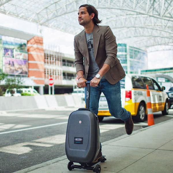 Ad for Steve Aoki Micro Kickboard Carry-On Luggage Scooter