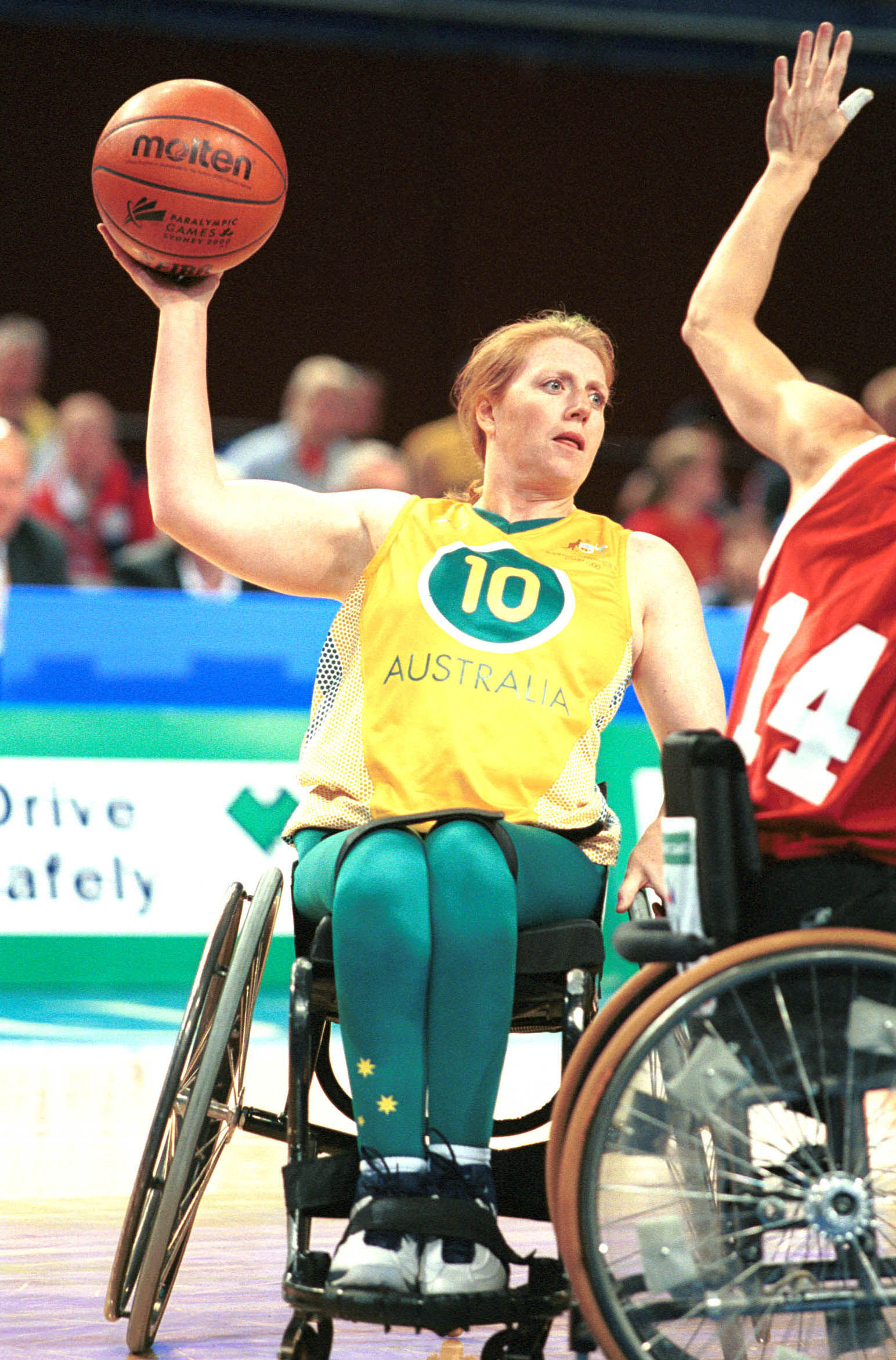 Australian wheelchair basketballer Jane Webb (now Sachs) passes the ball during 2000 Sydney Paralympic Games match
