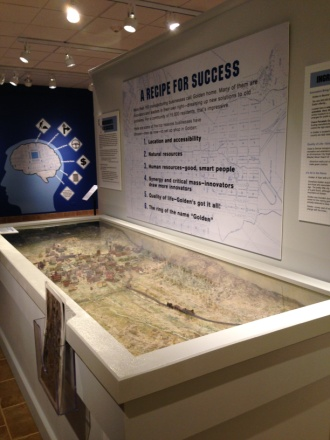 View of the Made in Golden exhibition, showing a diorama of the town from 1938-39, and a list of reasons why over 150 manufacturing businesses call Golden home.