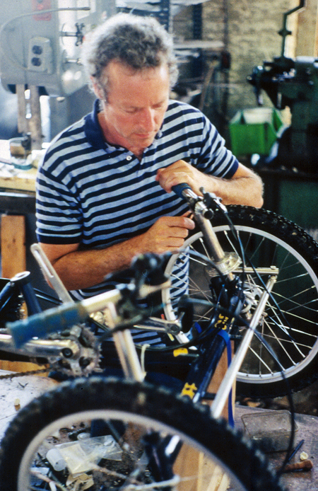 Mike Augspurger working on a handcycle wheel in his workshop