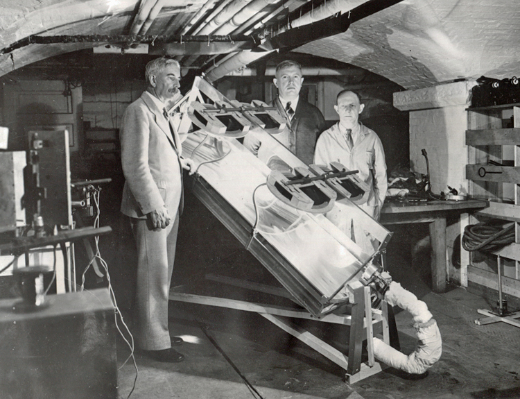 Smithsonian Secretary Charles G. Abbot with assistants testing a solar engine, 1935