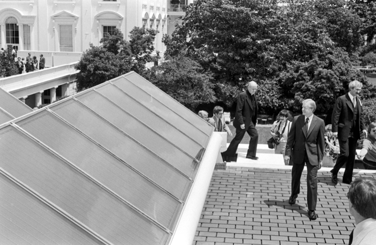 President Jimmy Carteron the roof of the White House inspecting solar thermal panels, 1979