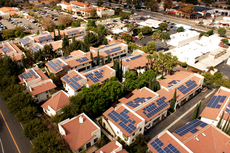 Aerial view of olar panels installed on many rooftops