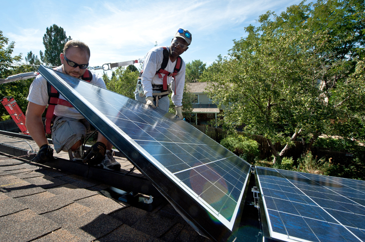 Workers installing solar panels on a home in Englewood, Colorado, 2012