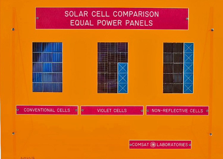 Comsat solar cell display comparing power outputs of different cells, around 1975