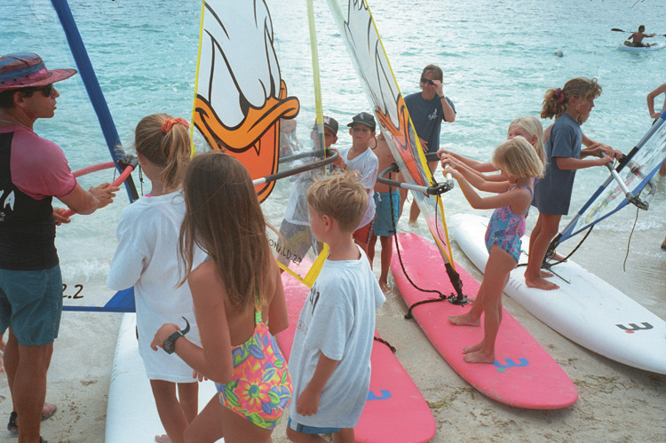 8 children, 4 windsurfers, and 2 instructors teaching kids to use a sailboard, about 2010
