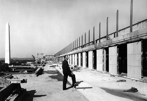 Founding director Frank Taylor stands on the Museum's 5th floor terrace, surveying construction.