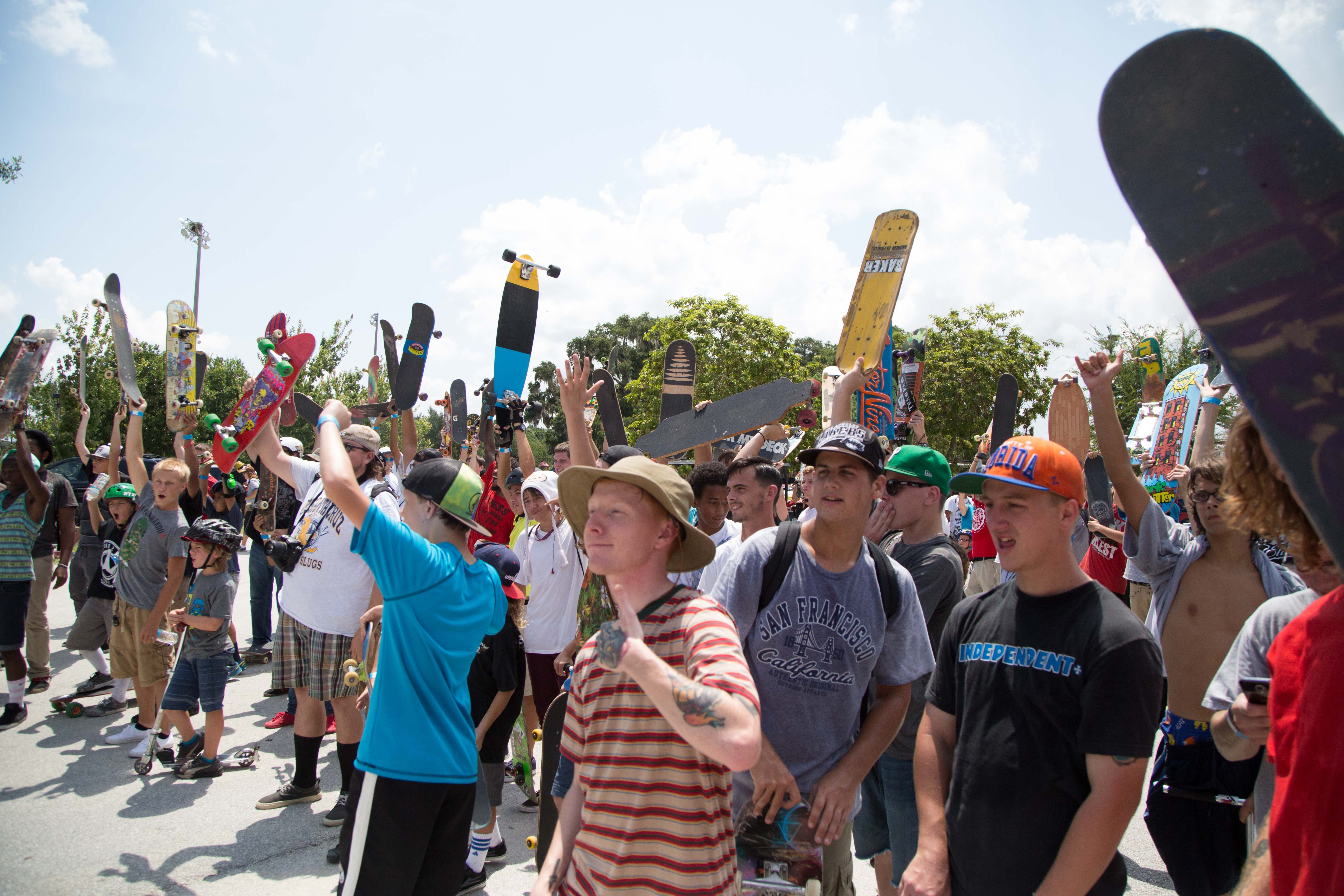 The crowd cheers on the best skateboarding trick winner at Innoskate in FL