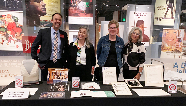 Lemelson staff with inventors Lisa Lindahl and Hinda Miller, at table display of Jogbra archival materials