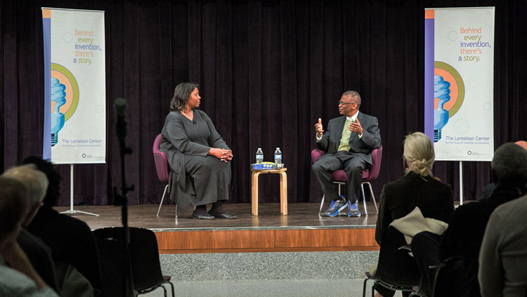 Lisa Cook and Lonnie Johnson talking on stage