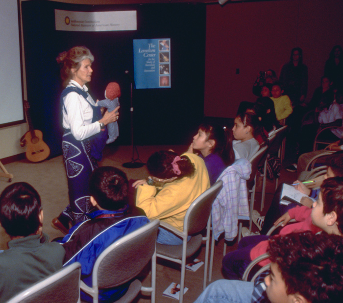 Image of Ann Moore demonstrating the Snugli 1999