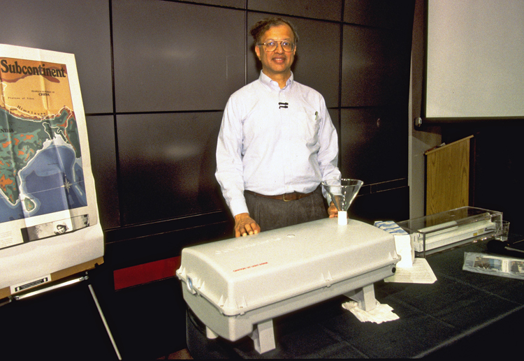 Ashok Gadgil with his invention, the UV Waterworks, 1998