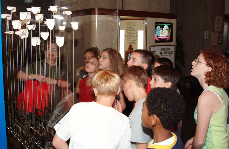 Students view a kinetic sculpture by Arthur Ganson