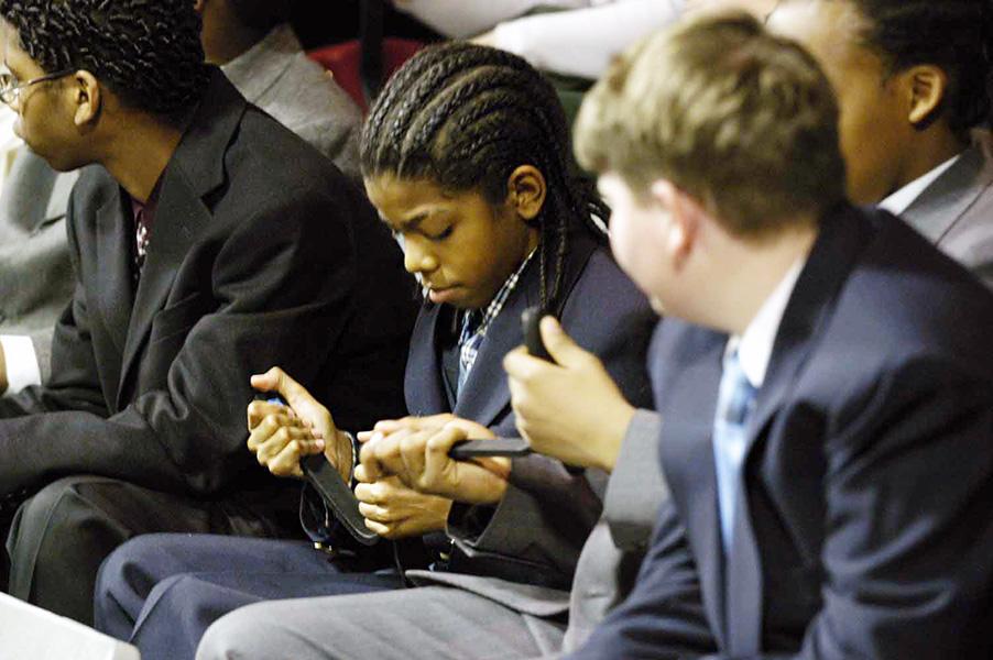 Students examine Flex-Foot models at the Innovative Lives program