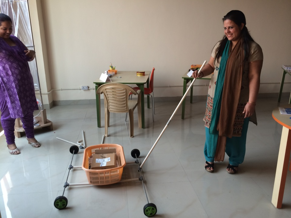 Spark!Lab India staff invent a vehicle out of PVC pipe.