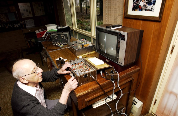 Ralph Baer kneeling at Brown Box console