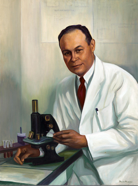 An oil portrait on canvas of Charles Richard Drew. He is wearing a white lab coat and seated at and touching a microscope, but he is looking at the painter, not through the microscope.