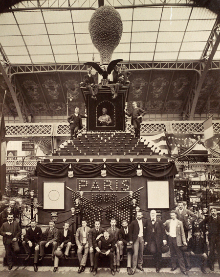 Hammer and his colleagues sitting around the 45-foot tall lamp at the Edison pavilion, 1889 Paris Exposition