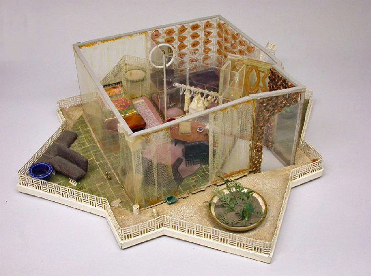 View looking down on model of self-cleaning house