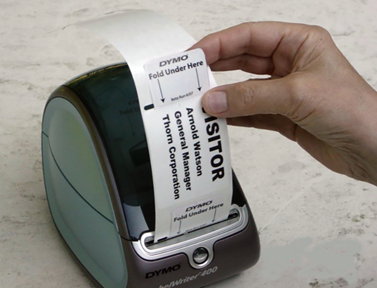 A small thermal printer producing a time badge.