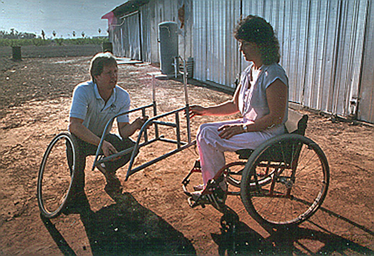 Hamilton and Helman looking at wheelchair frame