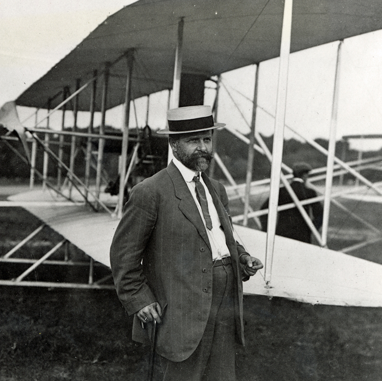William Hammer standing alongside the Wright Type A Military Flyer