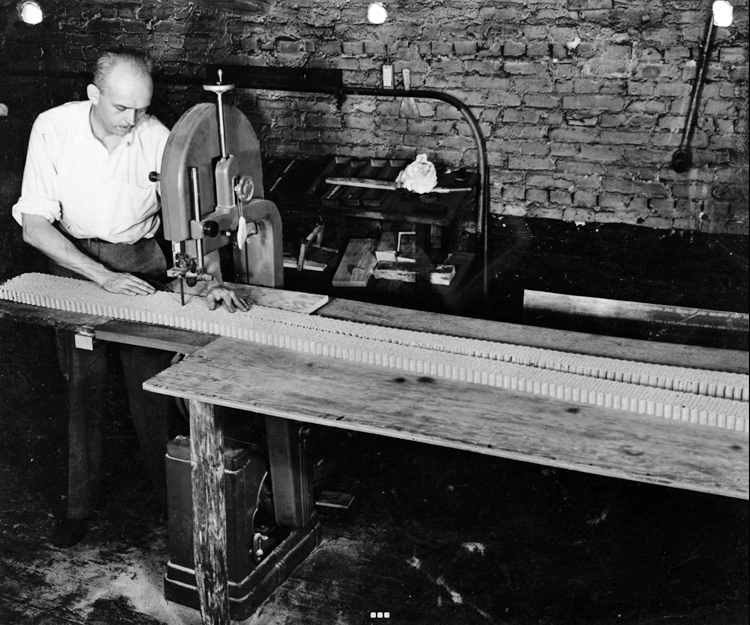 Howard Head cutting the honeycomb core for his skis.
