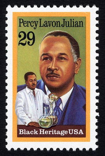 Color 29-cent US postal stamp captioned Black Heritage USA features a head-and-shoulders portrait of Percy Lavon Julian, with an inset in the lower left corner of Julian pouring a chemical through a filter into a flask, with a second flask in foreground.