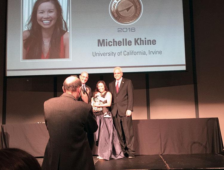 Khine receiving award