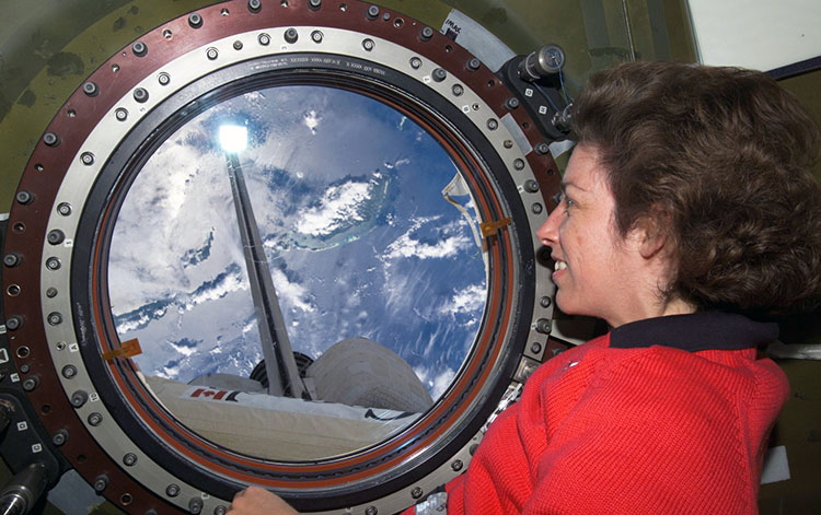 Ochoa looking out space station window