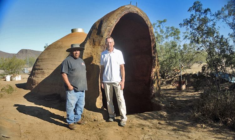 Richard Pablo (left) and David Stone standing outside the Ferrock structure they built at the Tohono Oodham Nation Community College