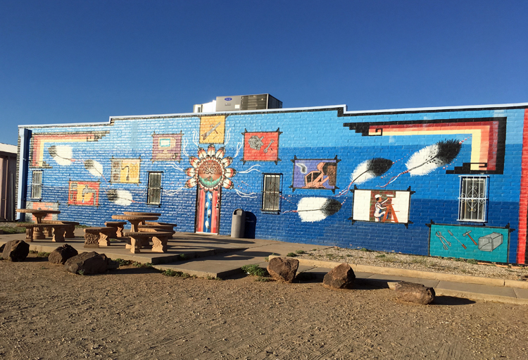Facade of the Tohono Oodham Community College, brightly painted with Native American symbols