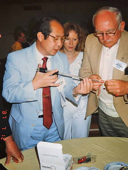 Dr. Yoon demonstrating device in convention setting